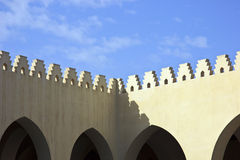 Wall of Mosque with battlement. The wall of Mosque with battlement and blue sky Royalty Free Stock Photo