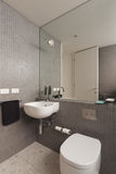 Wall Mounted Basin Vanity In Fully Tiled Mosaic Bathroom Royalty Free Stock Photo
