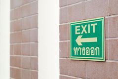 Wall Mounted Exit Sign. Shows People Way Out Public Building Royalty Free Stock Photo