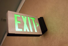 Wall Mounted Exit Sign Shows People Way Out Public Building. Lighted Wall Mounted Exit Sign Shows People Way Out Public Building Royalty Free Stock Photo