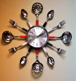 Wall mounted kitchen clock royalty free stock image