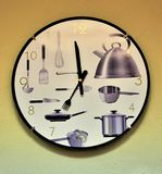 Wall mounted kitchen clock royalty free stock images