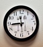 Wall mounted kitchen clock stock photos