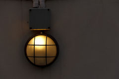 Wall mounted lamp. On a concrete wall Stock Photo