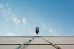 Wall Mounted Light Turned Off on Building Wall Under Blue Sky Royalty Free Stock Image