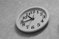 Wall-mounted mechanical quartz clock in black and white stock photos