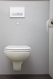 Wall mounted toilet with a concealed cistern Stock Photography