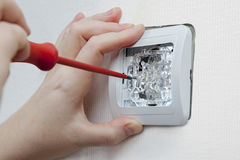 Wall mounting household light switch using screwdriver, electric Stock Image