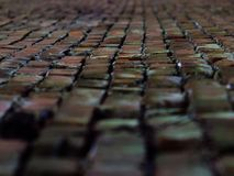 The wall stretches down perspective background. Wall moving away perspective background as bricks angle nail look the closer the farther the Wallpaper substrate Royalty Free Stock Images