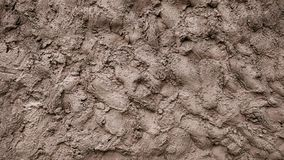 A wall of mud, cement putty decorative background, a mixture of earth smeared on the ground, a pattern of clay on the. A wall of mud, cement putty decorative stock photo