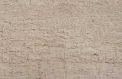 Wall of mud texture background Stock Images