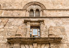 Wall with Mullioned windows with lava stone inlays of the Palace Steri Chiaramonte, Palermo, Sicily, Italy Royalty Free Stock Images