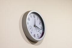 The wall multipurpose clock of bey color Royalty Free Stock Photo