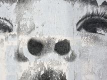 Wall mural, female face. Female face closeup on a textured wall Royalty Free Stock Photos