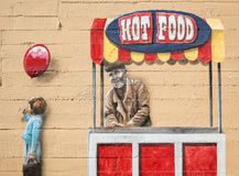 Wall mural, food vendor. Public wall painting, food vendor and girl Stock Photos