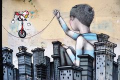 Wall mural painting by famous French street artist Seth Globepainter in Paris Royalty Free Stock Photography