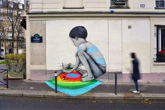 Wall mural painting by famous French street artist Seth Globepainter in Paris Royalty Free Stock Images