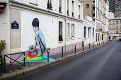 Wall mural painting by famous French street artist Seth Globepainter in Paris Stock Image