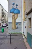 Wall mural painting by famous French street artist Seth Globepainter in Paris Royalty Free Stock Image