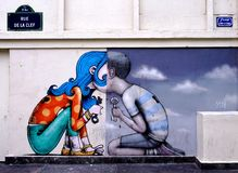 Wall mural painting by famous French street artist Seth Globepainter in Paris Stock Photos