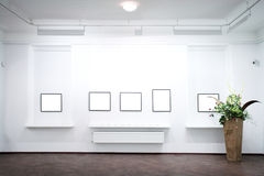 Wall in museum with frames Stock Images