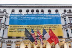 The Wall Museum with Ukrainian flag in Berlin,Germany. stock images