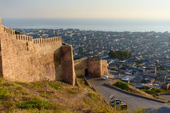 Wall of Naryn-Kala fortress and view of Derbent city. Stock Image