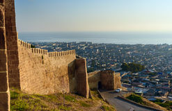 Wall of Naryn-Kala fortress and view of Derbent city. Stock Photography
