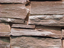 Wall of natural brown stone Royalty Free Stock Photos