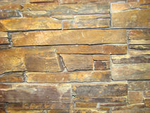 Wall of natural brown stone Stock Images