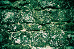 Wall of natural stone with lichen Royalty Free Stock Images