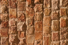 The wall of natural stone. Wall with rough hewn stones Royalty Free Stock Images