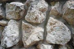 The wall of natural stones of different sizes stock image