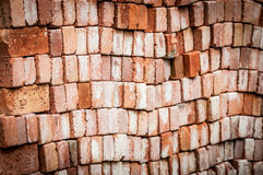 Wall of new red bricks stacked in rows. Royalty Free Stock Image