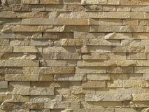 Wall of ocher bricks Royalty Free Stock Photography