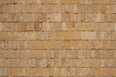 Wall of ochre bricks. Wall of small bricks from ochre granite Royalty Free Stock Photos