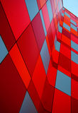 Wall of an office building. Red and blue wall of an office building on a background of blue sky Stock Photo