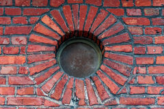 Wall of an old brick building and round window Stock Photo