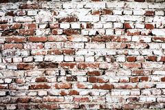 Wall of old brick with a white touch abstract background stock photography