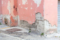 Wall of an old building with ruined plaster. Stock Image