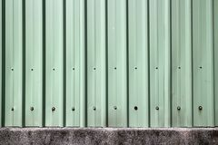 The wall of the old building, symmetrical texture of gray-black material, as in construction, in Asia. The wall of the old building Royalty Free Stock Photos