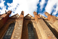 Wall of old church in Chelmno - Poland. Old church in Chelmno - view on wall and  stained-glass  windows Stock Photography