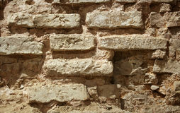 Wall. Of the old damaged bricks Stock Image