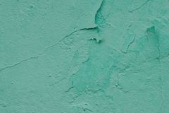 Wall with old exfoliating paint mint color. Green background Royalty Free Stock Photo
