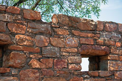 WALL OF OLD FORT IN RUINS UNDER TREE Royalty Free Stock Photos
