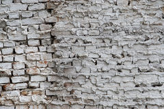 Wall of the old house from the brick and plaster painted in Royalty Free Stock Photos