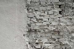 Wall of the old house from the brick and plaster painted in Royalty Free Stock Photo