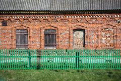 Wall of an old house with closed windows Royalty Free Stock Images