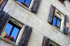 Wall of the old house with shutters in Treviso Stock Photos