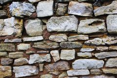 The wall of the old house of wild and limestone royalty free stock images